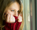 Sad Girl Looking Out The Window Waiting For Her Husband Royalty Free Stock Photo - 42938245