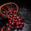 Cherry Falling From Basket Stock Photography - 42960652