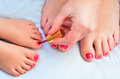 Mother And Child Paint Their Feet With Nail Polish Stock Images - 42962794