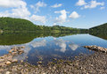 Ullswater By Pooley Bridge Lake District Cumbria Rocky Shore Blue Sky And Sunshine Royalty Free Stock Photos - 42976738