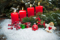 Red Candles Burning  In Snow For Fourth Advent Stock Images - 42978304