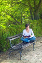 Woman Reading Book In The Park Royalty Free Stock Images - 42982179