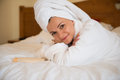 Beautiful Woman In Bathrobe On Bed Royalty Free Stock Photos - 42987298