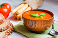 Tomatoe Soup With Bread Sticks And Basil On Wooden Background Stock Photo - 42992870
