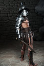 Gladiator In Helmet And Armour Holding Sword Stock Photos - 42994313