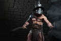 Gladiator In Helmet And Armour Holding Sword Stock Photo - 42994700