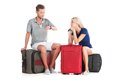Frustrated Couple Waiting Departure With Luggage. Royalty Free Stock Images - 43011069