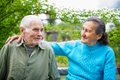 Cute 80 Plus Year Old Married Couple Posing For A Portrait In Their Garden. Love Forever Concept Stock Image - 43013641