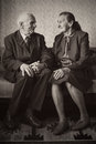 Cute 80 Plus Year Old Married Couple Posing For A Portrait In Their House. Love Forever Concept Royalty Free Stock Photography - 43013657
