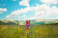 Happy Little Girl Jumping On The Field Royalty Free Stock Photos - 43024418