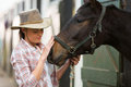 Cowgirl Talking Horse Royalty Free Stock Photo - 43033915