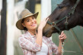 Cowgirl Horse Stable Royalty Free Stock Image - 43033926