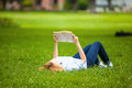 Woman Lying In Grass And Reading A Book Stock Images - 43041994