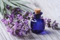 Lavender Oil In A Glass Bottle On A Background Flowers Royalty Free Stock Photo - 43045285