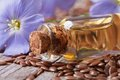 Flowers And Flax Seed, Oil In Glass Bottle Macro Stock Photos - 43045843