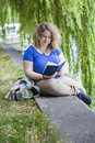 Young Woman Reading A Book Royalty Free Stock Image - 43053376