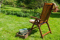 Wooden Chair Books And Hat In Garden Stock Photography - 43054422