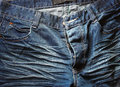 Close Up Of Worn Blue Jeans. Royalty Free Stock Photo - 43070565