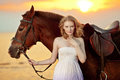 Beautiful Woman Riding A Horse At Sunset On The Beach. Young Gir Stock Image - 43107501