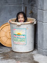 Homeless Girl Bathes In A Plastic Bucket, Philippines Royalty Free Stock Images - 43108969