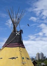 Indian Tipi With Calgary Skyline In Background. Stock Image - 43111171