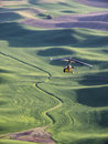 Ultra-light Plane Flies Over Wheat Fields On The Rolling Hills Royalty Free Stock Photos - 43116748