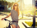 Trendy Hipster Girl With Bike In The City Royalty Free Stock Image - 43117676