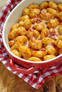 Gnocchi With Tomato Sauce And Parmesan Cheese Royalty Free Stock Photo - 43120905