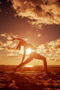 Young Beautiful Slim Woman Silhouette Practices Yoga On The Beac Stock Photos - 43123853
