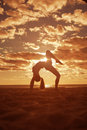 Young Beautiful Slim Woman Silhouette Practices Yoga On Beach Royalty Free Stock Photos - 43123978