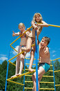 Three Cheerful Children On Bar At The Playground Stock Images - 43163944