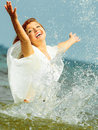 Vacation. Girl Splashing Water Having Fun On The Sea. Royalty Free Stock Images - 43164479