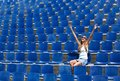 Young Woman Sitting In Stadium Cheering Royalty Free Stock Photo - 43172245
