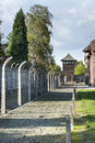 Outdoor Walkway Lined With Electrified Barbed Wire In Auschwitz Camp II Royalty Free Stock Photos - 43179058