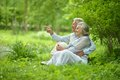 Elderly Couple Sitting On Grass Stock Images - 43184214
