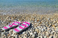 Flip Flops On Pebbled Beach Closeup Stock Images - 43206284