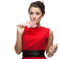 Caucasian Woman In Red Dress Licking Lollipop Stock Image - 43221411