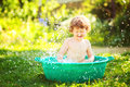 Little Boy Taking Water Procedures In Summer Garden. Royalty Free Stock Images - 43223149