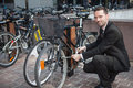 Businessman Unlock His Bike After A Day Of Work Stock Images - 43262084