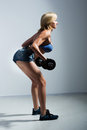 Athletic Woman Pumping Up Muscules With Dumbbells Stock Photos - 43273903