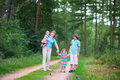 Beautiful Family Hiking In A Pine Wood Stock Image - 43309851