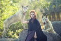 Lovely Woman Posing With Wolves Outdoors Royalty Free Stock Images - 43313329