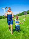 Kids In Summer Day Holds Windmill Stock Photos - 43334403