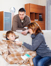 Man And Woman Caring For Sick Teenager Royalty Free Stock Photography - 43369887