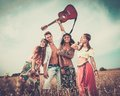 Multi-ethnic Hippie Friends On A Road Trip Royalty Free Stock Photos - 43383718