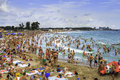 Crowded Beach And People In The Waves Royalty Free Stock Photos - 43404248