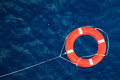 Lifebuoy In A Stormy Blue Sea, Safety Equipment In Boat. Stock Photo - 43412970