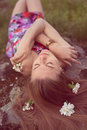 Close Up Portrait Of Beautiful Blonde Young Woman Laying On Stone With Flowers In Her Hair Closing Eyes Dreaming Outdoors Royalty Free Stock Images - 43418049
