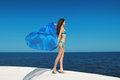 Enjoyment. Fashion Model Woman With Blowing Tissue Over Blue Sky Stock Photography - 43422062