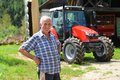 Proud Farmer Standing In Front Of His Tractor Stock Image - 43422251